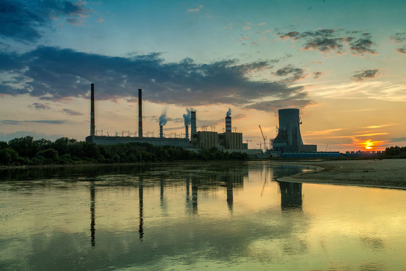 Power Stations Architecture Beauty In Nature Built Structure City Cloud Cloud - Sky Cloudy Idyllic Nature No People Orange Color Outdoors Reflection Rippled Scenics Sky Sunset Tranquil Scene Tranquility Water Wooden Post