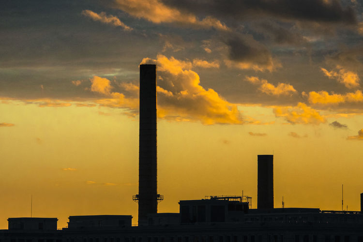 NY Sky Sunset Building Exterior Built Structure Architecture Smoke Stack Factory Cloud - Sky Industry Pollution Environmental Issues Orange Color No People Smoke - Physical Structure Nature Air Pollution Silhouette Environment Outdoors Emitting Ecosystem  Atmospheric