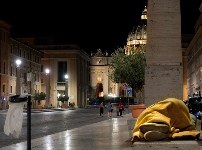 The paradox of Christianity Architecture SanPietro City Italy Rome Night Homeless Poor  Poverty Solitude And Silence Solitudine Solitude Disparity Religion Paradox Illuminated Outdoors History Clochard Nightphotography Building Exterior People Pope EyeEmNewHere