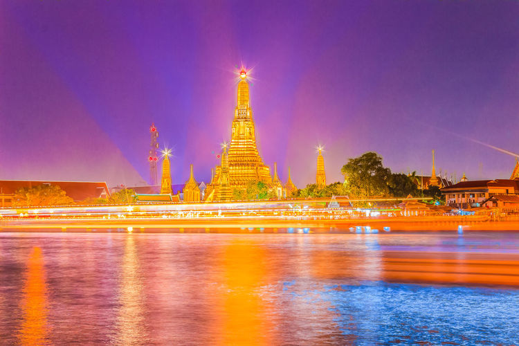 Beautiful cityscape view of Wat Arun Rajwararam temple with light trail from the Chao Phraya river cruises and light shows at night, the popular tourist attraction and one of the symbols of the city. Wat Arun Wat Arun (Temple Of Dawn) Wat Arun Ratchawararam Ratchawarama Wat Arun Temple Wat Arun Temple, Thailand Wat Arun, Bangkok Wat Arun Thailand