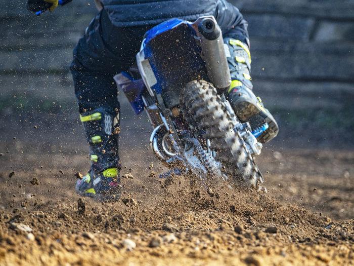 Man riding motorcycle in mud