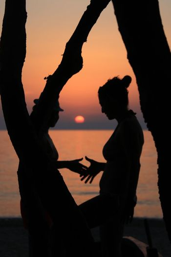 Sunset Romantic Silhouette Sunset Real People Orange Color Sky Two People Leisure Activity Lifestyles Adult Togetherness Side View Women Three Quarter Length Nature People Standing