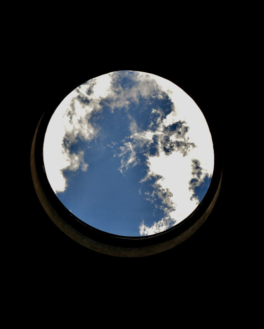 LOW ANGLE VIEW OF SKY SEEN THROUGH SILHOUETTE OF ARCH