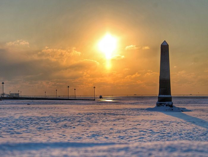 Foreground Shadow Seafront Snow Sun Cenotaph Sky Sunset Cold Temperature Snow Winter Scenics - Nature Water Tranquil Scene No People Beauty In Nature Cloud - Sky