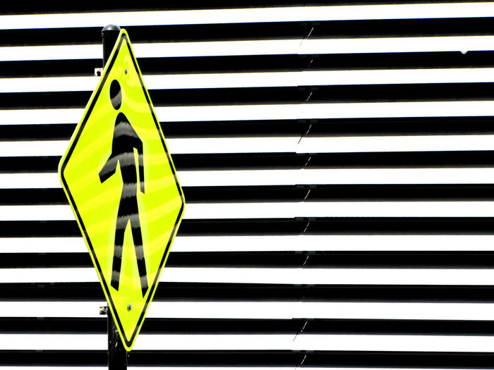 Background Backgrounds Black Color Close-up Color Contrast Crosswalk Day Minimal No People Pattern Protection Repetition Safety Security Shadow Shape Sign Striped Wall - Building Feature Yellow Zebra Crossing Visual Creativity