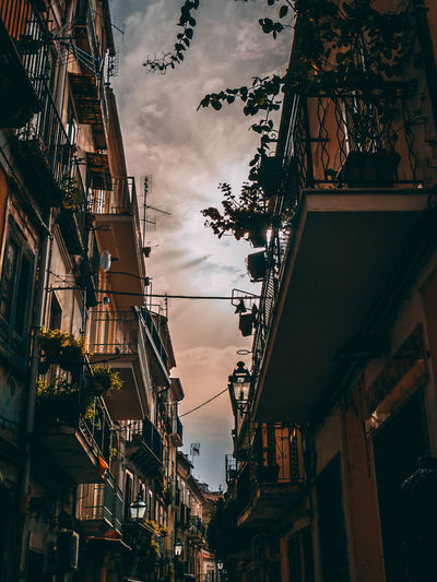 sun in town. pizzo, italy. Orangeandteal Visualvibes Cinematic Sunset View Sunny Cloudly Sunlight Buildings Alley Cities Building Architectureporn BuildingPorn ArchiTexture Tealandorange Vibrant Color Moody Sky Symetry Moody Pizzo Italy City Sky Architecture Cloud - Sky Building Exterior