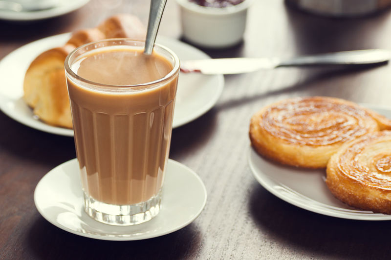 Galão: a Portuguese Coffee with Espresso and Warm Milk, with a Palmier and Croissant on Cafe Table Baked Goods Beverage Caffeine Coffee Shop Continental Breakfast Eating Pastel Power Baked Cafe Coffee Croissant Drink Elephant Ear Food Food And Drink Galao Glass Hot Drink Latte Nobody Palmier  Pastry Plate Portuguese Food Table