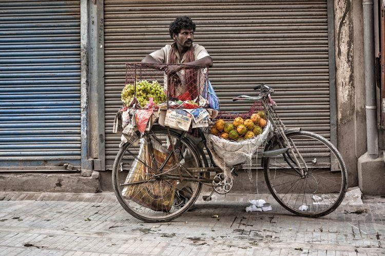 The Street Photographer - 2016 EyeEm Awards Outdoors Fruit Streetphotography Market Street Kathmandu Nepalese Nepali  Nepal People Man Bike Tangerine Grape