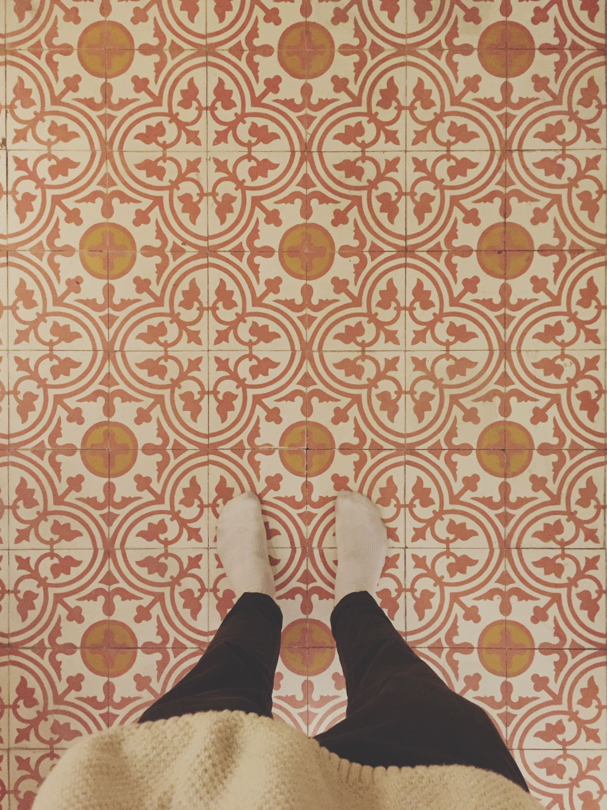 low section, person, indoors, lifestyles, personal perspective, standing, high angle view, shoe, leisure activity, human foot, pattern, flooring, tiled floor, men, unrecognizable person, footwear
