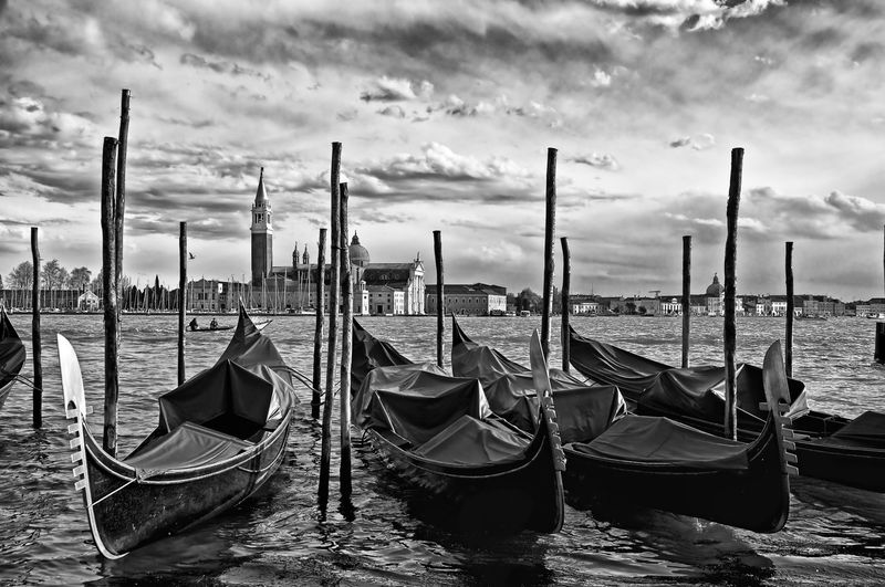 Gondolas outside San Marcos Square in Venice Architecture Built Structure Cloud - Sky Day Gondola Gondola - Traditional Boat Mode Of Transport Moored Nature Nautical Vessel No People Outdoors Sky Transportation Travel Destinations Water Wooden Post First Eyeem Photo