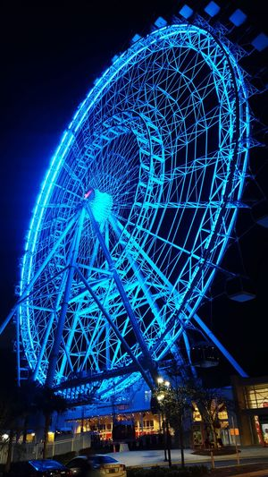The Orlando eye Theorlandoeye Orlandoeye Night Illuminated Arts Culture And Entertainment Amusement Park Ferris Wheel Low Angle View Blue Outdoors Sky City No People Nightlife