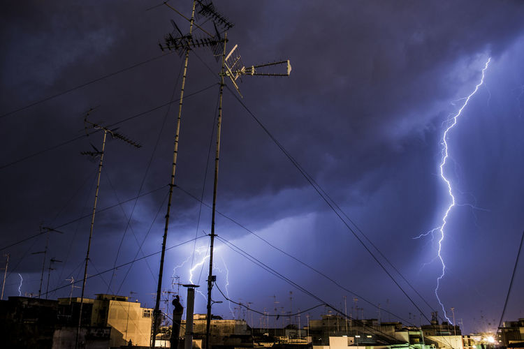 City Against Of Lightning In Sky At Night
