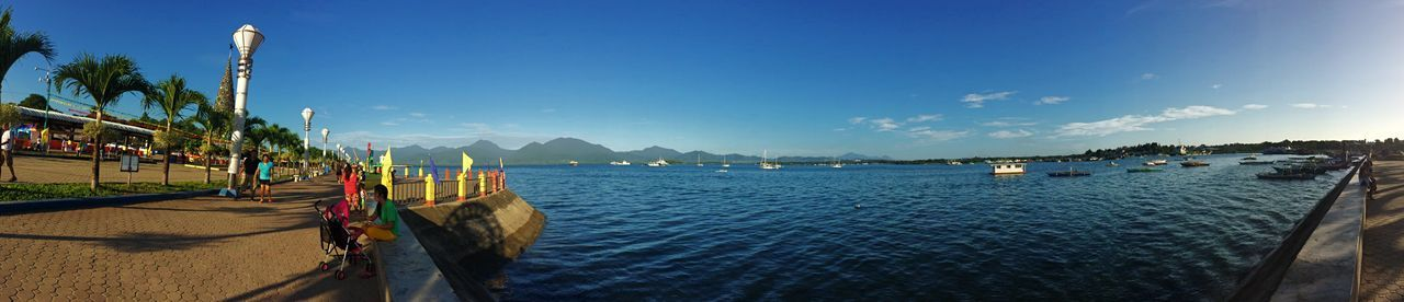 The Baywalk Water Blue Sky Sea Beauty In Nature Beach Nature Mountain Tree Traveling Home For The Holidays Puerto Princesa City Palawan Philippines Eyeem Philippines Finding New Frontiers EyeEm Best Shots Panorama Outdoors Built Structure Scenics No People Palm Tree Sand Architecture Day Art Is Everywhere