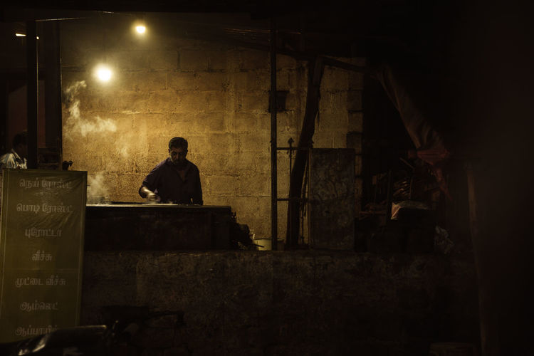 Man working in factory at night