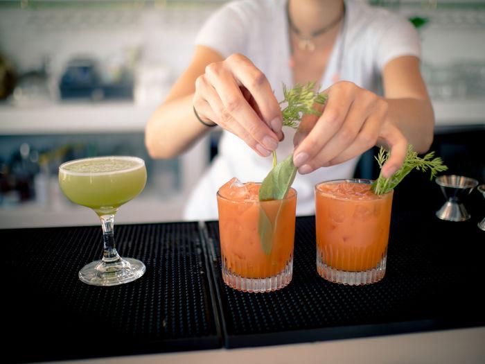 Close-up of bartender serving drinks at bar counter