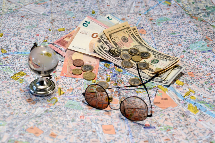 Sunglasses, a glass globe and money on a tourist map background. Tourism concept. Dollar Money Cash Savings Banking Finance Bill Currency Wealth Background Banknote Bussiness Profit Green Close-up USD Exchange Loan  Paper Sign Payment Pay Stack Number Textured  Abstract Earnings Symbol Capital Assets Sunglasses Map Tourism Euro Coins Travel Destination Concept Glass Globe Glass - Material Paper Currency Business No People Global Business Direction Global Finance Indoors  Corporate Business Investment World Map Coin Multi Colored Journey Toy Global Communications