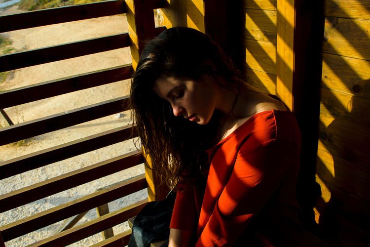 Thinking About Life Beautiful Woman Beauty Close-up Day One Person One Young Woman Only People Shadow The Secret Spaces Girl Shadows And Sunlight Wood The Portraitist - 2017 EyeEm Awards