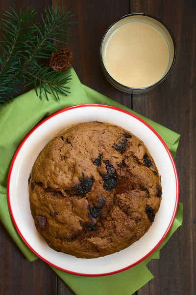 Traditional Chilean Pan de Pascua Christmas Cake made with spices, dried fruits and raisins, with a glass of Chilean Cola de Mono Christmas cocktail, photographed overhead with natural light (Selective Focus, Focus on the top of the cake) Chile Chilean  Christmas Cocktail Latin American Food  Pascua  Raisin South American Food Xmas Alcohol Alcoholic Drink Baked Cake Chilean Food Cola De Mono Dried Fruit Drink Food Food And Drink Latin American Pan Pan De Pascua Sweet Sweet Food Traditional
