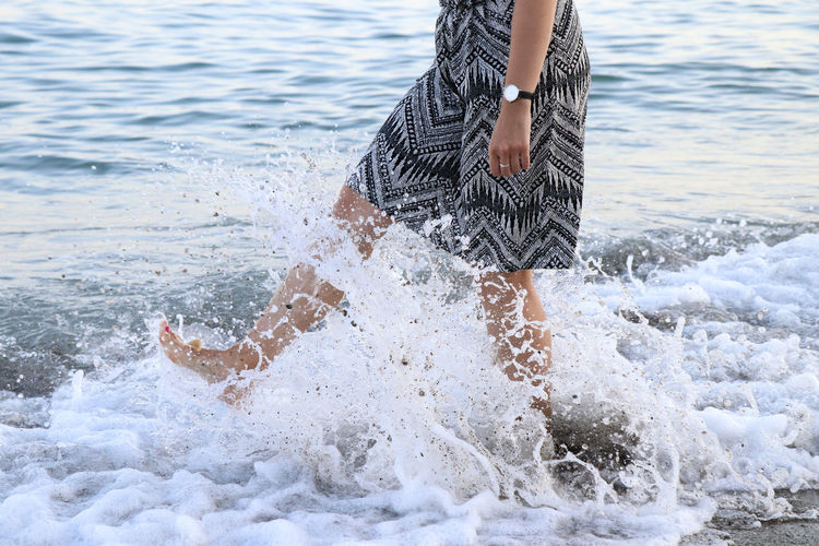 Woman kicking waves EyeEm Selects EyeEm Best Shots Water Sea One Person Motion Real People Lifestyles Day Nature Leisure Activity Splashing Beach Waterfront Human Body Part Low Section Wave Outdoors Body Part Girl Woman Holiday Dress Fun Splash Watch Enjoying Life