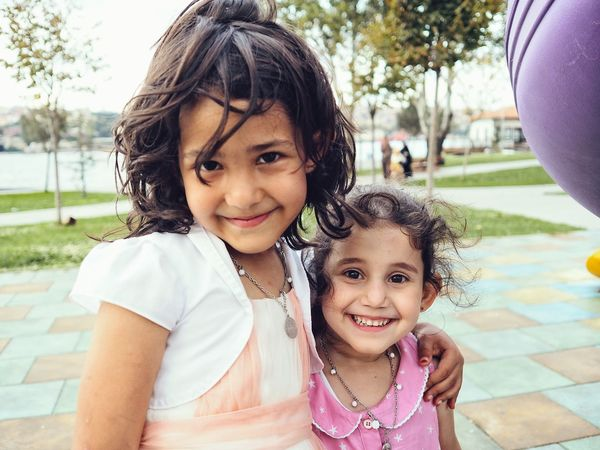 People And Places Two Girls are Playing in the Playground of the Public Park of Balat Istanbul Turkey Life Happiness Elementary Age Smile Childhood Friendship Lifestyles Enjoy The New Normal Outdoors Family Sister Togetherness Smiling Cute Friends
