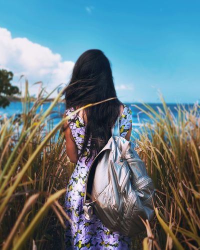 One Person Rear View Sea Nature Leisure Activity Sky Outdoors Long Hair Real People Day Beach Lifestyles Tranquility Tranquil Scene Standing Women Horizon Over Water Scenics Water Beauty In Nature Summer Summertime Nature Exploring