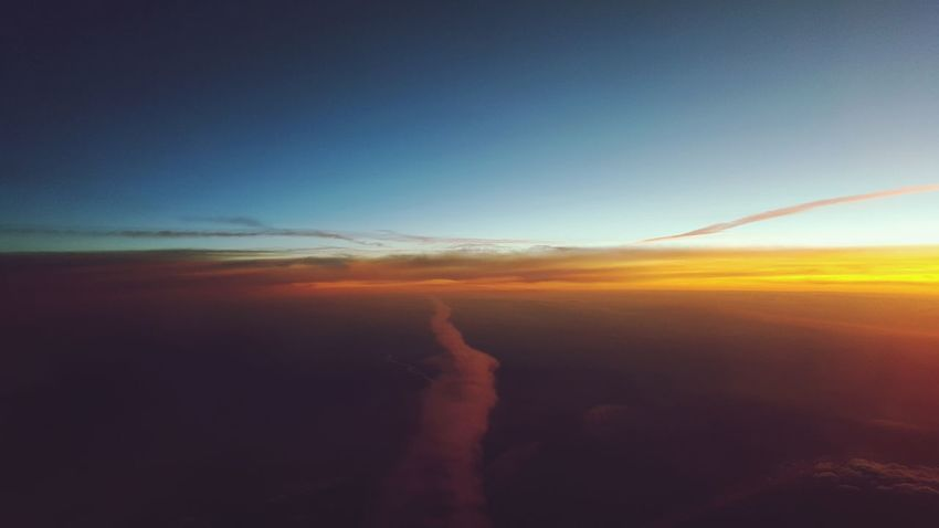 Scenics Travel Destinations Nature Outdoors Tranquility Aerial View Landscape Travel Sky Beauty In Nature Sunset No People Day Sea Water Horizon Over Water Airplane Cloud Formations Plane Shots Tranquility Clouds And Sky