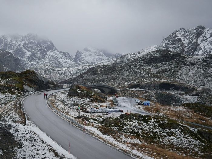 Scenic view of snowcapped mountains against sky - roadview