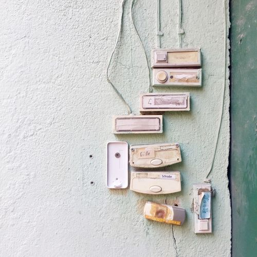Old doorbells mounted on white wall