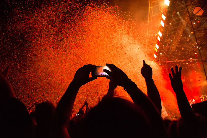 Silhouette Of People Photographing At Concert