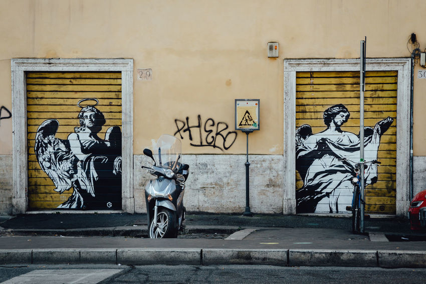 City Life Moving Around Rome Architecture Art And Craft Building Exterior Built Structure City Creativity Female Likeness Graffiti Human Representation Motorcycle Outdoors Scooter Street Art Transportation
