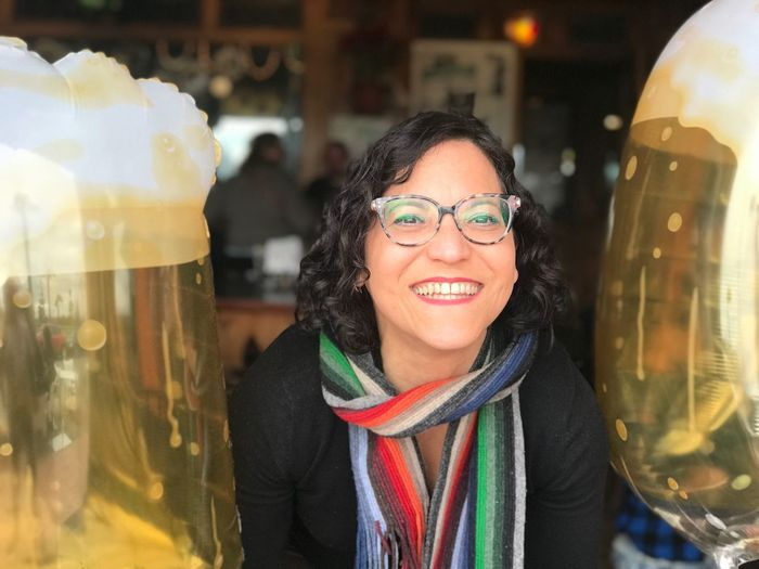 Beer time!! St. Patrick's Day Smiling Happiness Eyeglasses  Cheerful Lifestyles Real People Portrait Headshot One Person Young Women Young Adult Close-up One Woman Only Warm Clothing Looking At Camera Human Face Outdoors