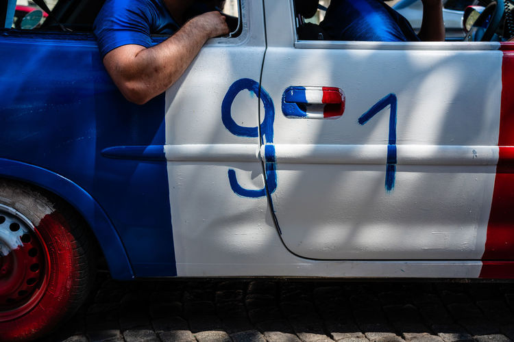 91 France Blue Car Day Finger Flag Hand Holding Human Body Part Human Hand Land Vehicle Lifestyles Men Midsection Mode Of Transportation Motor Vehicle Occupation One Person Outdoors Real People Transportation Working World Cup world cup 2018 The Photojournalist - 2018 EyeEm Awards The Traveler - 2018 EyeEm Awards The Portraitist - 2018 EyeEm Awards The Street Photographer - 2018 EyeEm Awards Capture Tomorrow