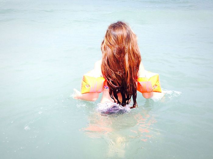 Rear View Of Girl In Sea