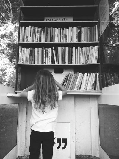 little booklover Little Girl Information Knihobudka Booklover Bookworm Books To Read Books, Books And Books. Knowledge Knowledge Is Power Clever Girl Book Corner Take A Book Black And White Photography Books Bookshelf Library Standing Book Education Learning Rear View Child Childhood Shelf One Girl Only Preschooler Human Back Primary Age Child Medium-length Hair Back