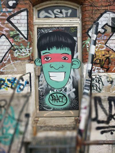 Graffiti Street Art Human Representation Graffiti Art And Craft Male Likeness Built Structure Spray Paint Smiley Face