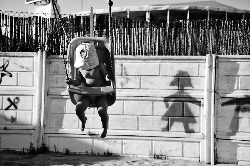 The shadow of the baby Shadow Shadows & Lights Children Only Swing Child Wall Wall Shadow Hat Street Photography Beach Sand Games Game EyeEmNewHere