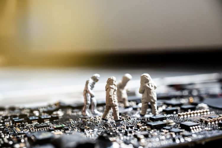 Close-up of figurines on computer chip