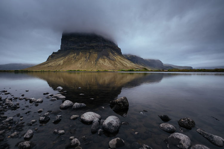 Water Sky Tranquil Scene Beauty In Nature Tranquility Scenics - Nature Rock Cloud - Sky Solid Rock - Object Nature Mountain Lake Idyllic Non-urban Scene No People Reflection Day Outdoors Iceland Island