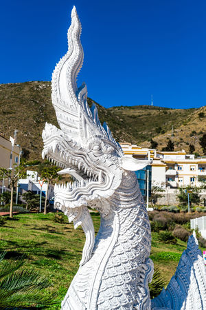 Dragon sculpture at the Butterfly Park in Benalmadena. The biggest butterfly park in Europe, it has over 1500 of the colorful little winged insects. Andalusia, southern Spain Andalucía Architecture Benalmádena, Malaga, Spain Dragon Dragon Sculpture Malaga Ornament SPAIN Statue Thai Architecture Blue Sky Building Exterior Butterfly Park Clear Sky Dragon Statue Landmark Mariposario No People Oriental Style Outdoors Pattern Sculpture