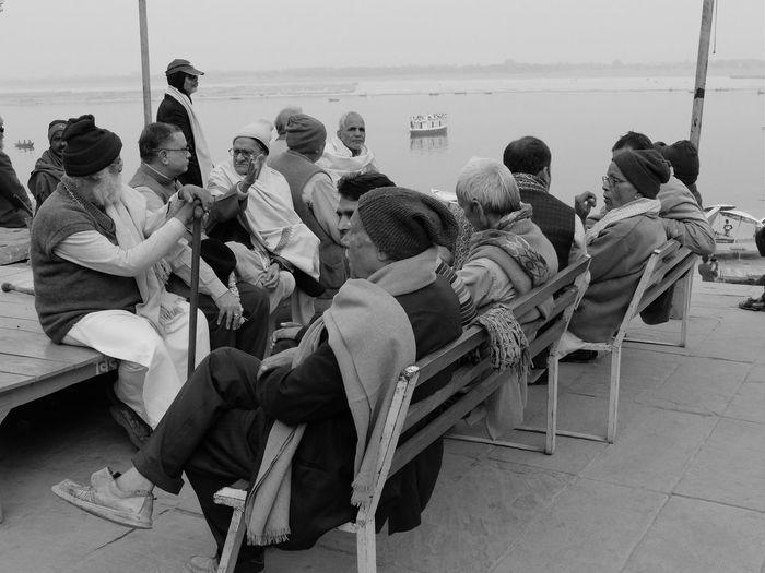 People sitting in boat against sky