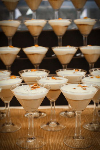 Close-up of dessert in martini glasses arranged on table