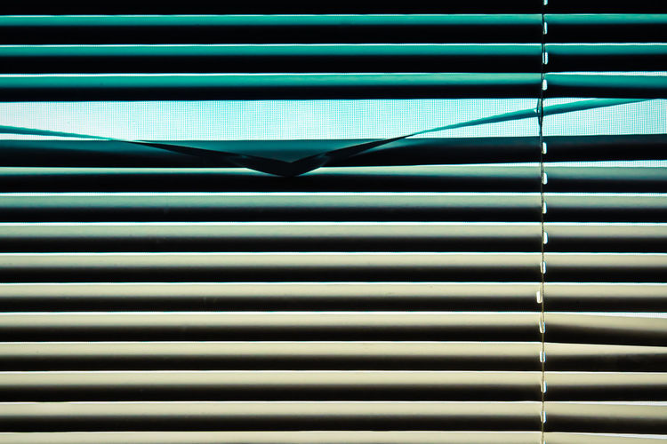 EyeEmBestPics Gradient Lines Lines And Patterns Peekaboo Through The Window Pattern No People Full Frame Backgrounds Window Close-up Blinds Indoors  Repetition Security Glass - Material Wall - Building Feature Abstract Metal Sunlight Reflection Protection Striped Silver Colored