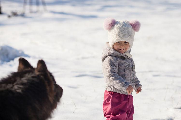 Boy standing in snow