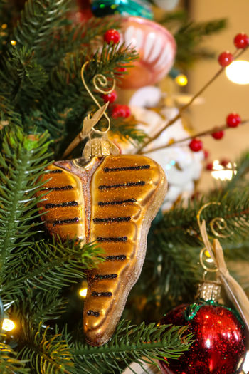 Grilled T-bone Steak Christmas Ornament hanging on food themed Christmas tree Food Theme Themed Christmas Tree Bauble Celebration Christmas Christmas Decoration Christmas Lights Christmas Ornament Christmas Tree Close-up Cultures Day Decoration Focus On Foreground Gold Colored Grill Hanging Holiday - Event Illuminated Indoors  No People T-bone Tradition Tree Tree Topper
