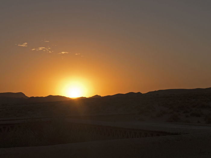 Sunset in the Sahara desert at Ouzina in Morocco Morocco Ouzina Land Sky Environment Scenics - Nature Landscape Tranquil Scene Sunset Tranquility Arid Climate Climate Beauty In Nature Outdoors Sunrise Africa Sand Evening Mood Mood Sand Dune Sun Idyllic Orange Color Silhouette Desert