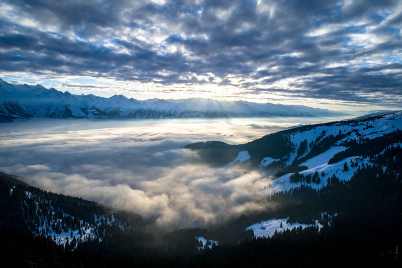 Alps Austria Zell Am See Winter Mountain Mountain Range Landscape View Sunset No People Tranquility Cloud - Sky Beauty In Nature Sky Nature Valley Cloud Cover Sunlight Romantic Sky Wild Aerial View Aerial Cold Temperature Mountain Peak Snowcapped Mountain