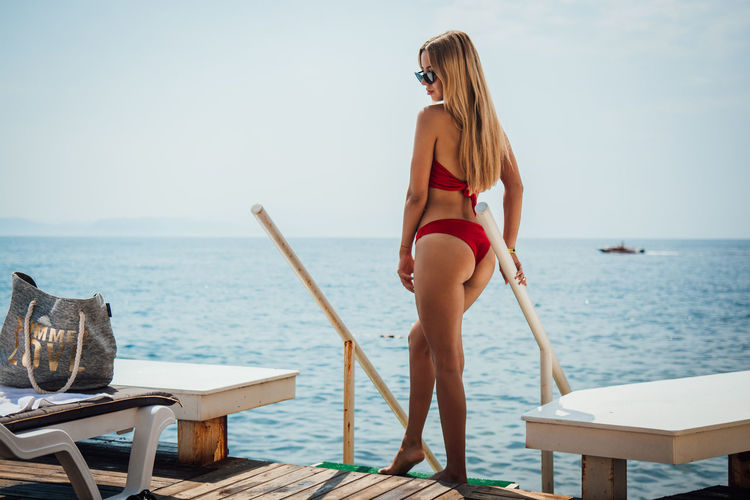 Water Sea Young Adult One Person Young Women Leisure Activity Lifestyles Standing Adult Women Sky Hair Real People Blond Hair Holiday Vacations Nature Beauty In Nature Fashion Horizon Over Water Hairstyle Beautiful Woman Outdoors