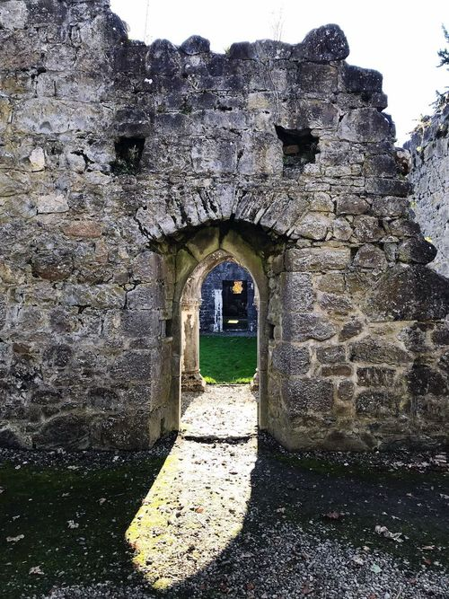 I love how the sunlight comes through the door of the Abbey! Architecture Built Structure History Old Ruin Stone Material Arch Day Ancient Building Exterior Outdoors Travel Destinations No People Ancient Civilization Doorway Low Angle View Grass Nature Sky