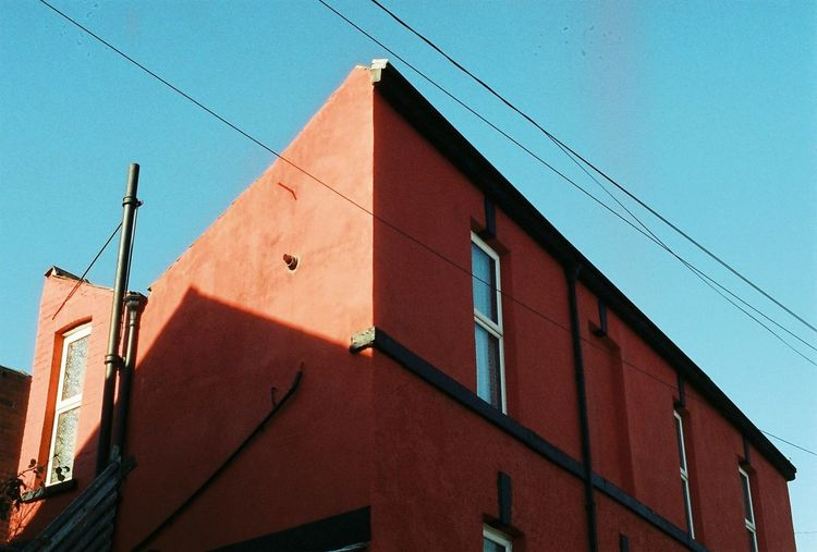 Architecture Red Building Building Exterior Cable Outdoors Sky Red Low Angle View Built Structure No People Day