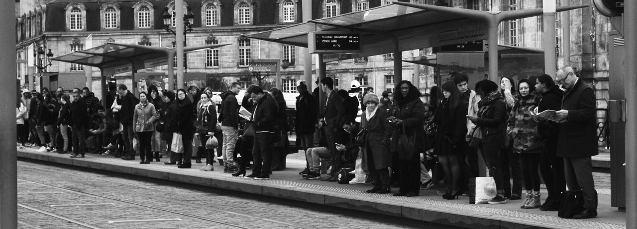 Next tramway in 2 minutes Bordeaux, France City Life Men Standing Station Tramway Urban Women